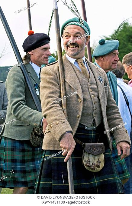 Men of the Lonach Highlanders marching at the annual Lonach Gathering and Highland Games at Strathdon, Grampian Region, Scotland