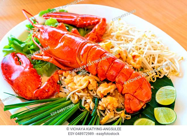 Lobster Pad thai, stir fried Thai rice noodle pasta with whole lobster and lobster meat