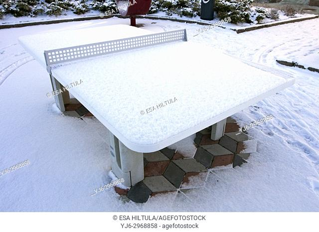 public table tennis table covered in snow, Finland