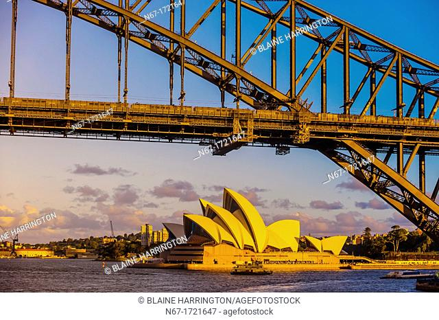 View of the Sydney Harbour Bridge and the Sydney Opera House from the mast of the tall ship 'Southern Swan', Sydney, New South Wales, Australia