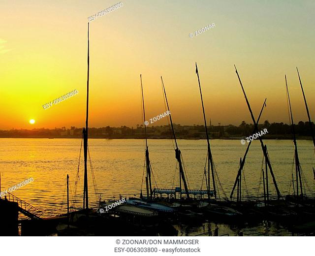 Felucca boats at the harbor at sunset, Luxor, Egyp