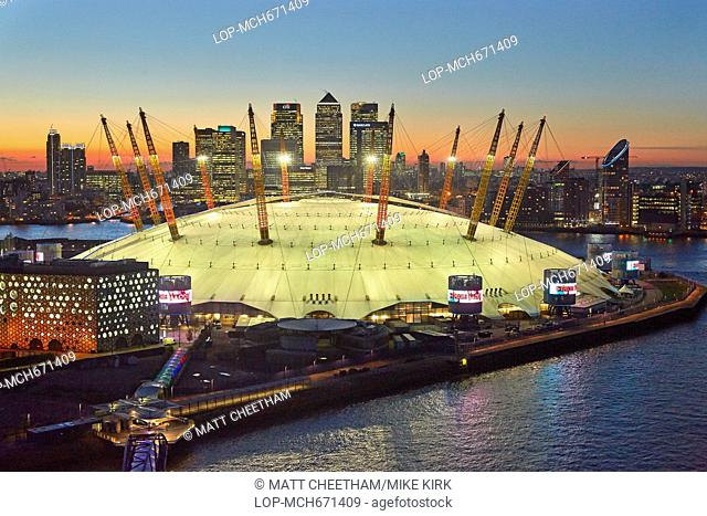A view from the Emirates Airline of the 02 Arena at sunset with Canary Wharf and the London skyline in the background