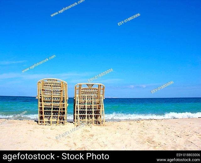 two chairs. beach