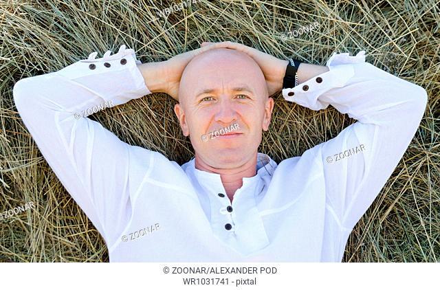man on hay