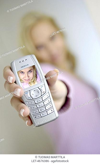 Woman with Nokia cell phone featuring camera