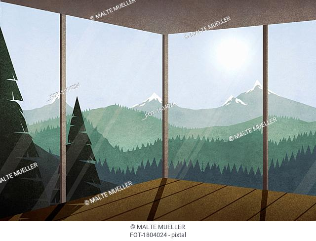 View of sun shining over idyllic mountain and forest landscape from glass house