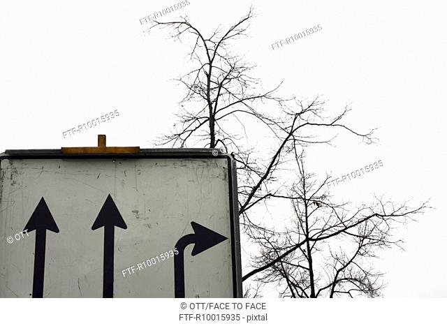Low angle view of a signboard consisting of three arrows