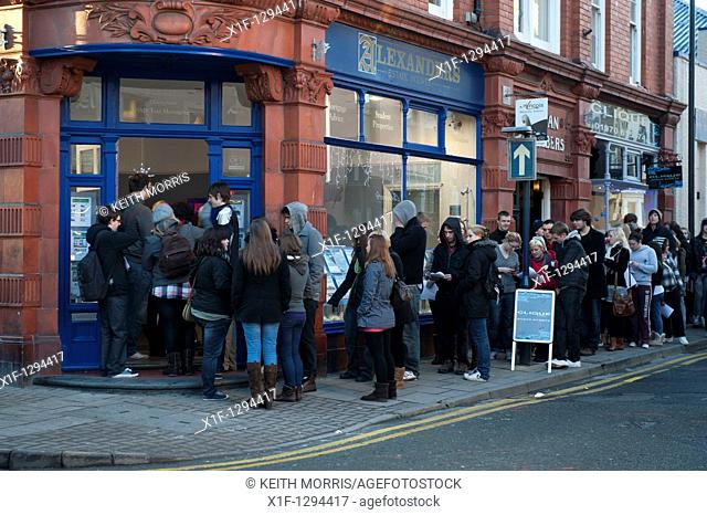 Aberystwyth University students queueing outside Alexanders estate agents to get hold of details of accomodation for the next academic year  Some had been...
