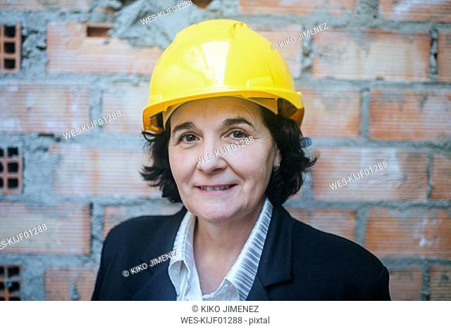 Portrait of confident woman wearing hard hat
