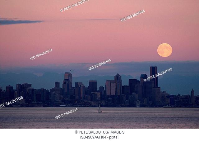 Moon over skyline, Seattle, USA
