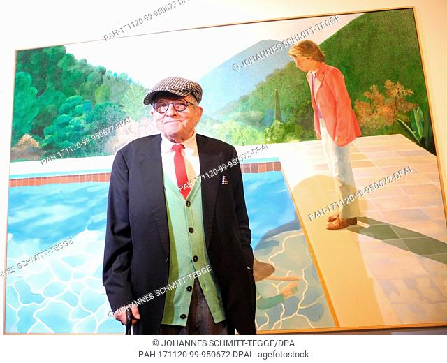 "David Hockney standing in front of his """"Portrait of an Artist (Pool with Two Figures)"""" painting at the Metropolitan Museum of Art in New York, USA"