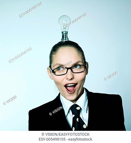 studio shot portrait of one caucasian young woman having little light over head