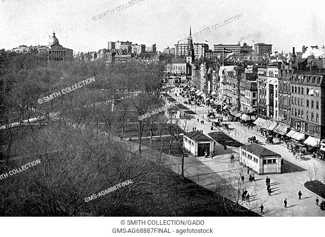 A photograph taken from a elevated position of the subway station entrances and exits along Tremont Street next to Boston Common