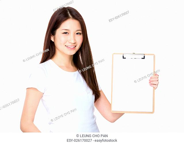 Woman showing a blank page of clipboard