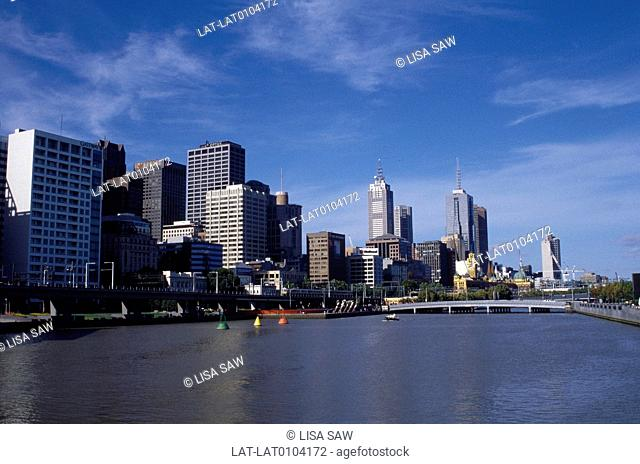 City view from Yarra River. Tall buildings,business district. Flat calm water