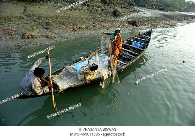A family fishing on the river in the Sundarbans The world's largest littoral mangrove forest by the Bay of Bengal, the Sundarbans has been declared a UNESCO...