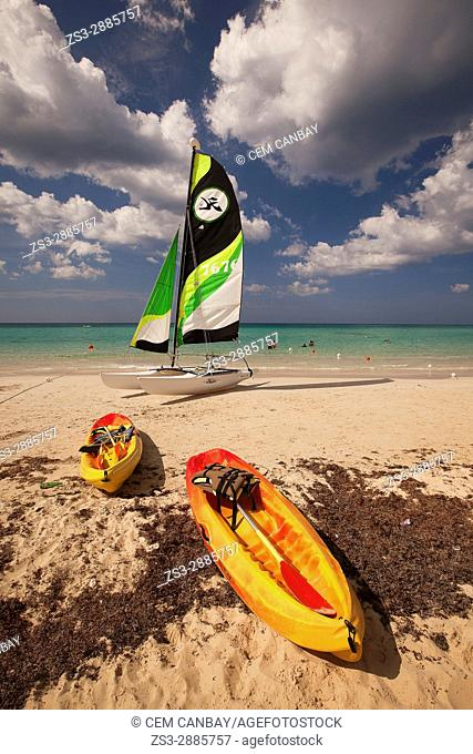 Scene from the Santa Maria del Mar beach with a catamaran and kayaks in the foreground, Playas del Este, La Habana, Cuba, West Indies, Central America