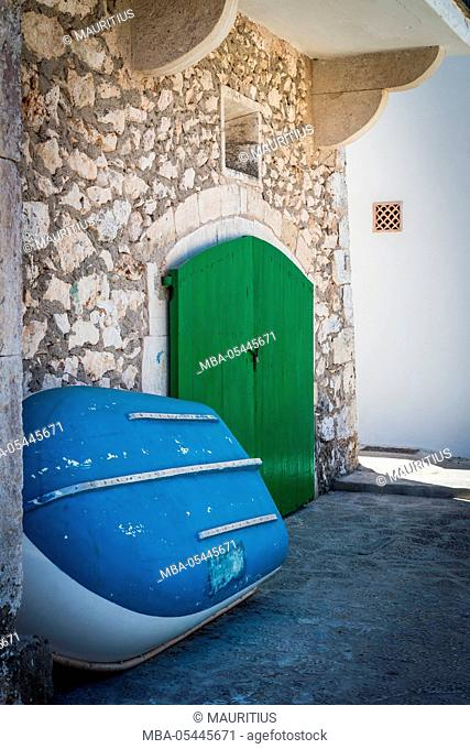 Boat, wall of a house