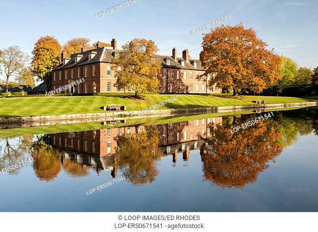 Gawsworth New Hall reflected in the lake