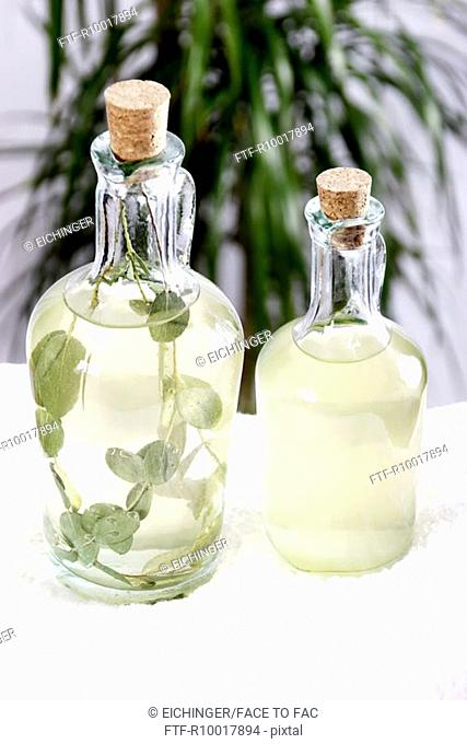 Massage oil in jugs, elevated view