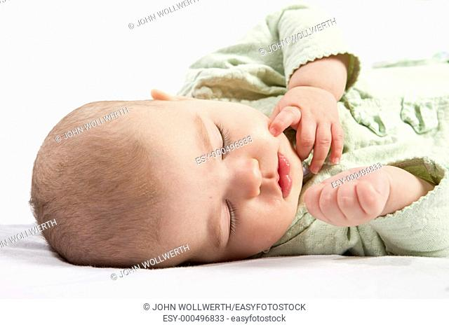 baby sleeping on white background