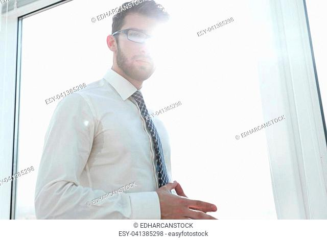 business background.blurry photo of a businessman next to a blank screen