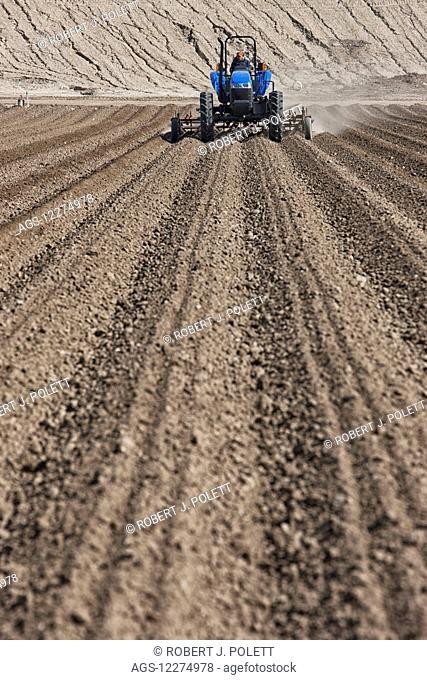 Ploughing field to ready for crops; Salinas, California, United States of America