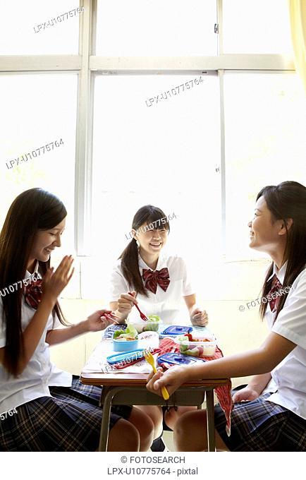 Three Female Students Having Lunch