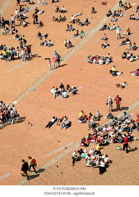 Siena, Italy, Tuscany, Toscana, Europe, Aerial view of people in the Piazza del Campo in the city of Siena from Torre del Mangia