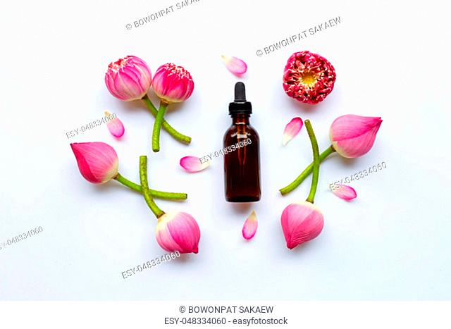 Lotus essential oil with lotus flowers on white background