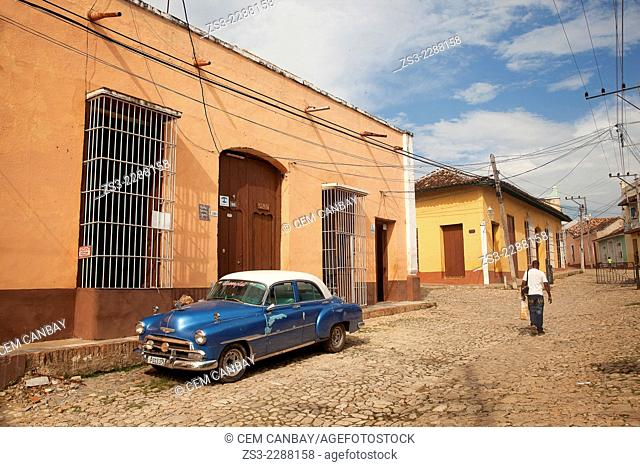 Old american car parked at the street side near Plaza Mayor,Trinidad, Santi Spiritus, Cuba, West Indies, Central America