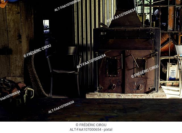 Wood burning stove in workshop