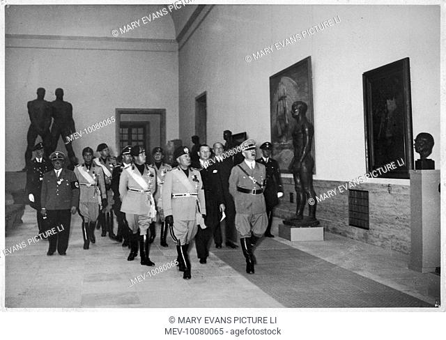 Hitler with Mussolini during his state visit to Germany.  Visiting the Munich Gallery of German Art. Left of Mussolini is the Italian Foreign Minister, Ciano