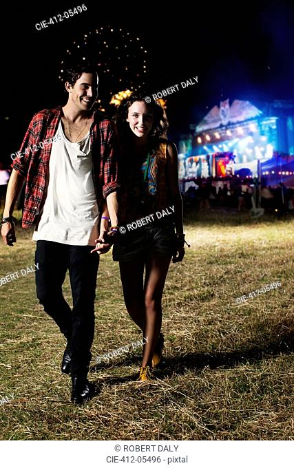 Couple leaving music festival