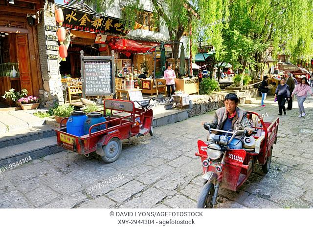 Shuhe Old Town World Heritage Site, Yunnan Province, China. Naxi ethnic people ancient site at Lijiang. Tea rooms and souvenir shops street scene