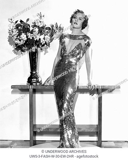 Hollywood, California: 1933.Nancy Carroll wearing a gown that was used in the film, The Woman Accused