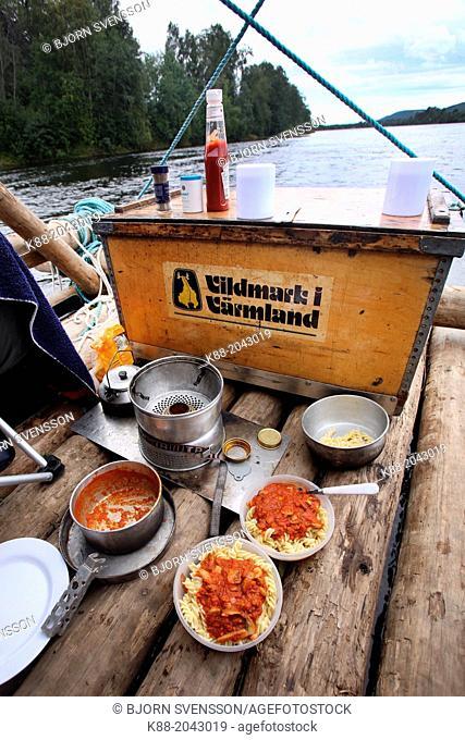 Cooking onboard a timber raft on Klar Alven. Varmland, Sweden