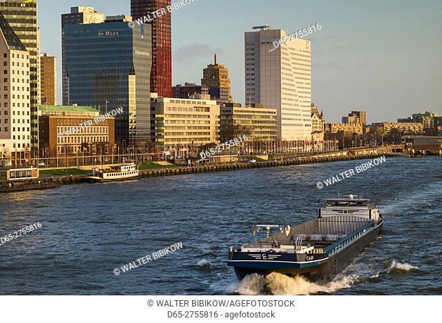 Netherlands, Rotterdam, city skyline along the Nieuwe Mass River, dawn
