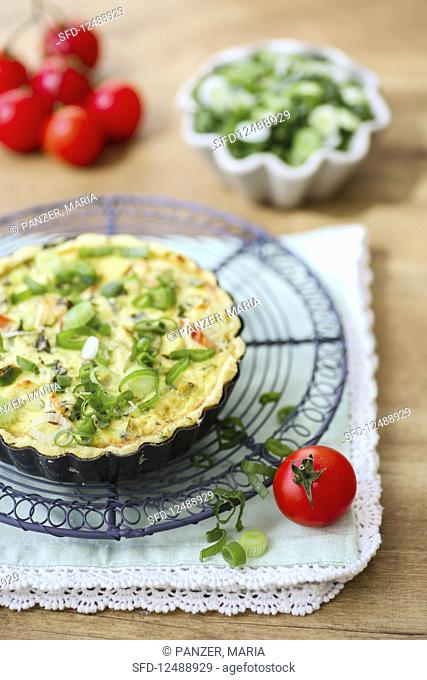 Vegetable quiche with spring onions