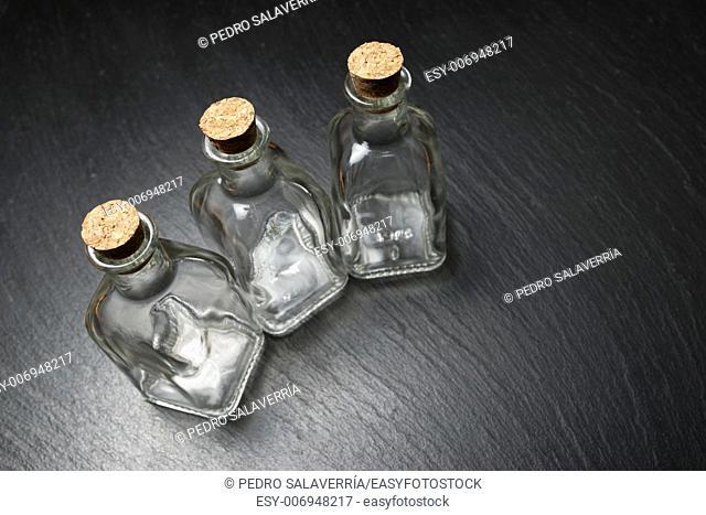 small empty bottles on a black slate