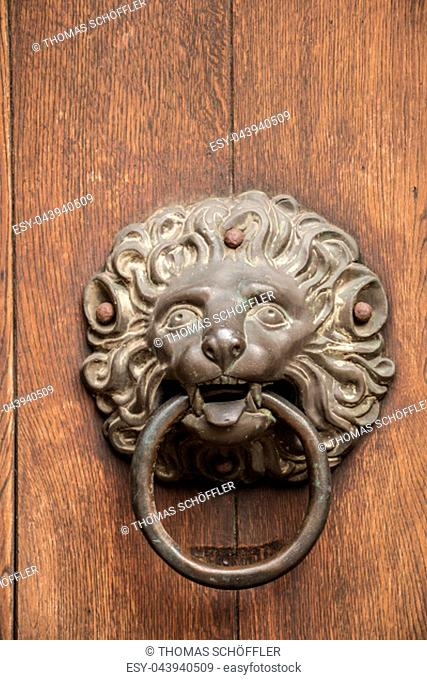 Door knob of an old historical building in shape of a lion made of iron