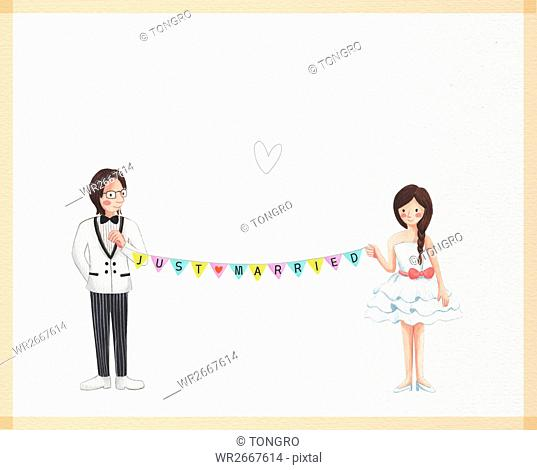 Smiling wedding couple standing holding party flags together