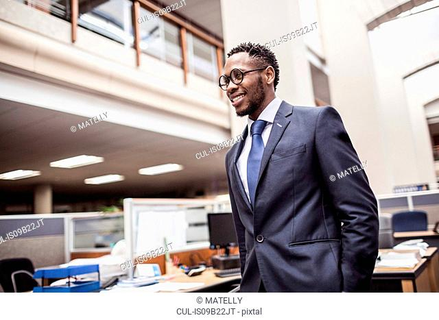 Confident young businessman in office