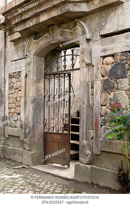 Old iron gate of a house in ruins, Aldeia das Dez, Portugal