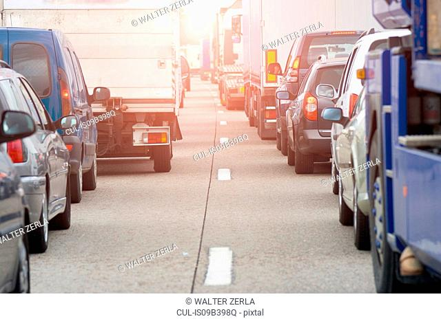 Rear view of rows of traffic queueing on highway