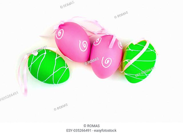 Easter decoration. Background with colorful eggs isolated on white with space for text