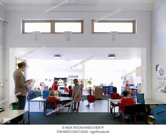Dulwich Village Infant School, London, United Kingdom. Architect: Cazenove Architects, 2012. Extension interior classroom, school children studying