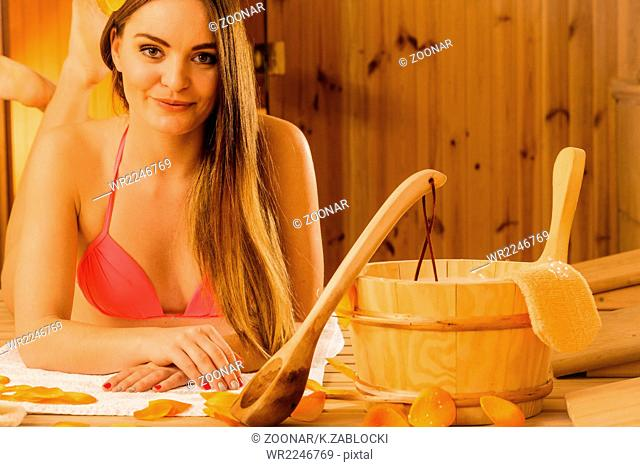 Woman relaxing in sauna. Spa wellbeing