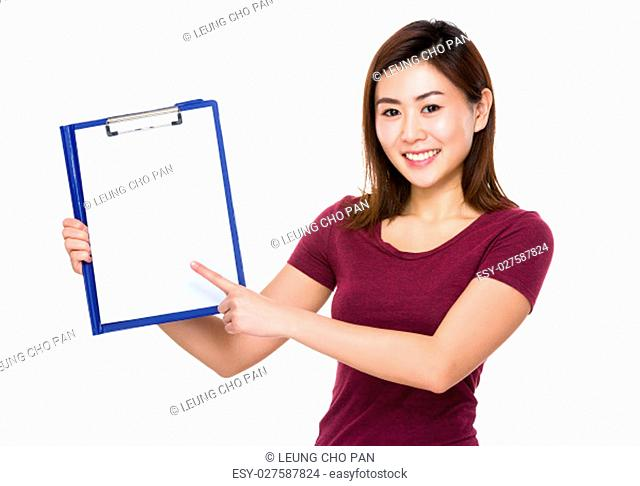 Asian young woman finger point to clipboard