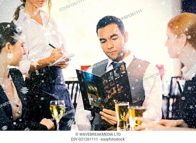 Handsome businessman ordering dinner from waitress